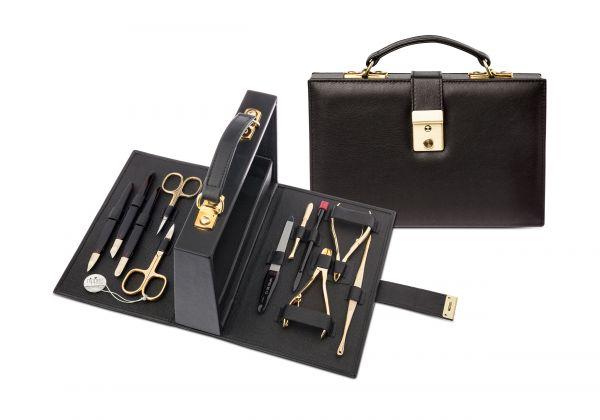 Maniküre-Set, 11-tlg., Instrumente vergoldet, Leder-Koffer schwarz